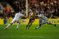 Nick Evans of Harlequins is sandwiched between Kieran Longbottom (left) and Alistair Hargreaves of Saracens during the Premiership Rugby Round 2 match between Harlequins and Saracens at The Twickenham Stoop on Friday 12th September 2014 (Photo by Rob Munro)