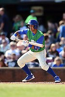Lexington Legends second baseman Ramon Torres (2) lays down a bunt during a game against the Hagerstown Suns on May 19, 2014 at Whitaker Bank Ballpark in Lexington, Kentucky.  Lexington defeated Hagerstown 10-8.  (Mike Janes/Four Seam Images)