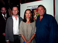 Montreal, 1999-08-30.<br /> <br />  Co director ; Frederic Aubertin (left), French actor and director ;  GÈrard Depardieu (right)and his wife the actress Carole Bouquet (middle) leaving after the  news conference about their  movie ``Un pont entre deux rives `` that is part of the Official Competition at the World Film Festival in Montreal (Quebec, Canada)<br /> Photo : (c) Pierre Roussel, 1999<br /> KEYWORDS : Gerard Depardieu , Carole Bouquet, French cinema,celebrities, World Film Festival, Montreal, Canada