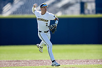 Michigan Wolverines shortstop Benjamin Sems (2) makes a throw to first base during the NCAA baseball game against the Illinois Fighting Illini on March 20, 2021 at Fisher Stadium in Ann Arbor, Michigan. Michigan won the game 8-1. (Andrew Woolley/Four Seam Images)