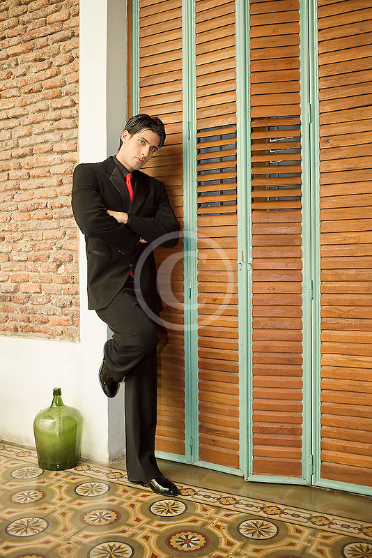 Argentina, Buenos Aires, Tango dancer, solo portrait, young man standing