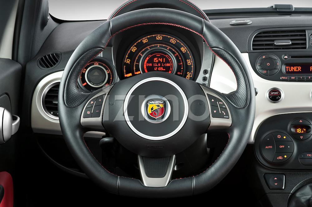 Steering wheel view of a 2009 Fiat 500 Abarth 3 door hatchback