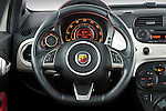 Steering wheel view of a 2009 Fiat 500 Abarth 3 door hatchback