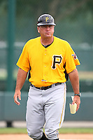 GCL Pirates manager Tom Prince #14 walks to the dugout after exchanging lineup cards before a game against the GCL Braves at Disney Wide World of Sports on June 25, 2011 in Kissimmee, Florida.  The Pirates defeated the Braves 5-4 in ten innings.  (Mike Janes/Four Seam Images)