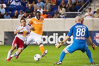 Connor Lade (16) of the New York Red Bulls challenges Macoumba Kandji (9) of the Houston Dynamo for the ball as he shoots on New York Red Bulls goalkeeper Bill Gaudette (88). The New York Red Bulls defeated the Houston Dynamo 2-0 during a Major League Soccer (MLS) match at Red Bull Arena in Harrison, NJ, on August 10, 2012.