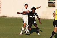 RICHMOND, VA - SEPTEMBER 30: Bo Cummins #83 of New York Red Bulls II is defended by Manny Perez #2 of North Carolina FC during a game between North Carolina FC and New York Red Bulls II at City Stadium on September 30, 2020 in Richmond, Virginia.
