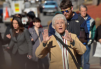 STAFF PHOTO BEN GOFF  @NWABenGoff -- 11/25/14 Gladys Tiffany speaks during a protest organized by the OMNI Center for Peace, Justice & Ecology in front of the Washington County Courthouse in Fayetteville on Tuesday Nov. 25, 2014. Four demonstrators volunteered to make a statement by being arrested. The demonstration was in response to the decision Monday night by the St. Louis County grand jury not to indict police officer Darren Wilson, who fatally shot Michael Brown in Ferguson, Mo.