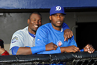 Daytona Cubs outfielder Jorge Soler #27 with teammate Frank Del Valle #43 in the dugout before a game against the Brevard County Manatees at Spacecoast Stadium on April 5, 2013 in Melbourne, Florida.  Daytona defeated Brevard County 8-0.  (Mike Janes/Four Seam Images)