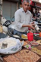 Kathmandu, Nepal.  A Street Vendor Sells Pop Corn and Nuts to Customers, Downtown Kathmandu.