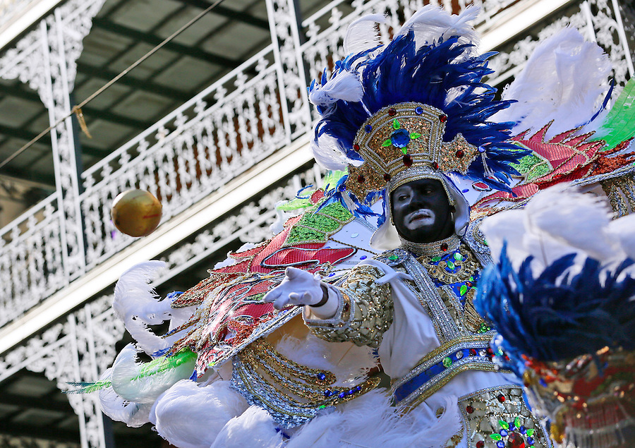 NEW ORLEANS, LOUISIANA - FEBRUARY 9, 2016:  A member of the Zulu Social Aid and Pleasure Club throws a coconut during Mardi Gras day on February 9, 2016 in New Orleans, Louisiana. Fat Tuesday, or Mardi Gras in French, is a celebration traditionally held before the observance of Ash Wednesday and the beginning of the Christian Lenten season. (Photo by Jonathan Bachman/Getty Images)