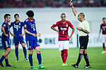Suwon Midfielder Lee Jong Sung gets a yellow card from Fifa Referee Ali Sabah Al-Qaysi of Iraq (R) during the AFC Champions League 2017 Group G match between Guangzhou Evergrande FC (CHN) vs Suwon Samsung Bluewings (KOR) at the Tianhe Stadium on 09 May 2017 in Guangzhou, China. Photo by Yu Chun Christopher Wong / Power Sport Images