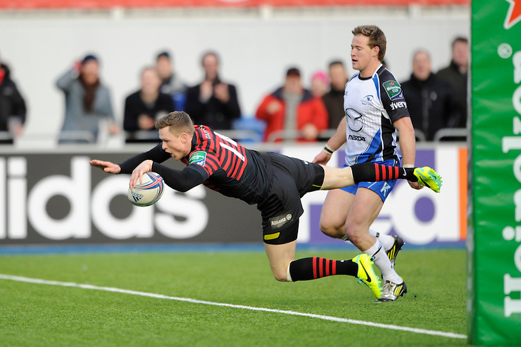 Chris Ashton of Saracens dives over to score a try during the Heineken Cup Round 6 match between Saracens and Connacht Rugby at Allianz Park on Saturday 18th January 2014 (Photo by Rob Munro)