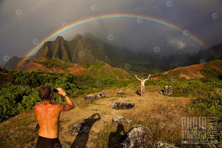 Photographing a moment with a Kalalau Valley double rainbow on the Na Pali Coast of Kauai