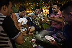 29/08/15. Shaqlawa, Iraq. -- A group of young displaced people from Al Anbar province play cards in a garden at the centre of the bazar where they meet regularly at the end of each day.