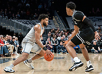 WASHINGTON, DC - FEBRUARY 19: Jagan Mosely #4 of Georgetown dribbles past David Duke #3 of Providence during a game between Providence and Georgetown at Capital One Arena on February 19, 2020 in Washington, DC.