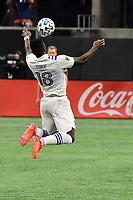 ATLANTA, GA - AUGUST 29: Daryl Dike #18 of Orlando City settles the ball during a game between Orlando City SC and Atlanta United FC at Marecedes-Benz Stadium on August 29, 2020 in Atlanta, Georgia.