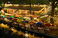 Famous River Walk restaurants and cafes of Casa Rio on water on holiday tourists in San Antonio Texas US