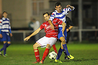 Chris Lockwood of Ilford tussles with Steve Parker of Clapton - Clapton vs Ilford - Essex Senior League Football at the Old Spotted Dog Ground, Upton Park, London - 01/10/13 - MANDATORY CREDIT: Gavin Ellis/TGSPHOTO - Self billing applies where appropriate - 0845 094 6026 - contact@tgsphoto.co.uk - NO UNPAID USE