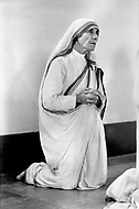 """Calcutta, India. April 04, 1975. Mother Teresa prays in the morning hours as part of the """"Missionaries of Charity"""" Mother Teresa (Agnes Gonxha Boyaxihu) the Roman Catholic, Albanian nun revered as India's """"Saint of the Slums,"""" was awarded the 1979 Nobel Peace Prize."""