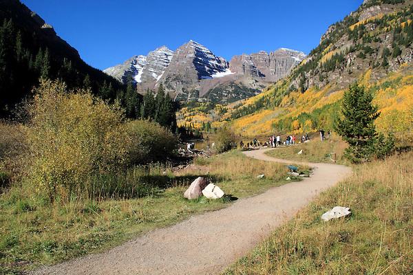 Hiking trail leading to the Maroon Bells, near Aspen, Colorado John offers autumn photo tours throughout Colorado. John offers fall foliage photo tours throughout Colorado. .  John leads hiking and photo tours throughout Colorado.