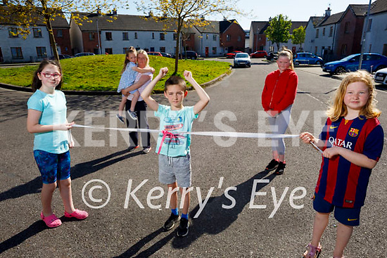 Thomas Walsh crosses the finish line after his 10k fundraising walk on Sunday in aid of Majella Kearney who has Leukaemia. Holding the ribbon, l to r: Leah and Amy O'Mahoney.Back l to r: Margaret and Emily Diggins and Alisha Moriarty.