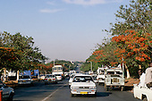 Lusaka, Zambia. Looking down the road towards the city centre with traffic.