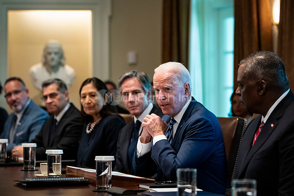 United States President Joe Biden speaks during a cabinet meeting at the White House in Washington, D.C., U.S., on Tuesday, July 20, 2021. Biden administration officials say they're starting to see signs of relief for the global semiconductor supply shortage, including commitments from manufacturers to make more automotive-grade chips for car companies. Pictured from left to right: US Secretary of Education Miguel Cardona, US Secretary of Health and Human Services Xavier Becerra, US Secretary of the Interior Debra Haaland, US Secretary of State Antony Blinken, President Biden, US Secretary of Defense Lloyd J. Austin III.<br /> Credit: Al Drago / Pool via CNP /MediaPunch