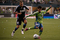 Fredy Montero (r) shoots against Darren Huckerby (l) in the Seattle Sounders 2-1 win against San Jose Earthquake on Saturday, June 13, 2009 at Quest Field in Seattle, WA.