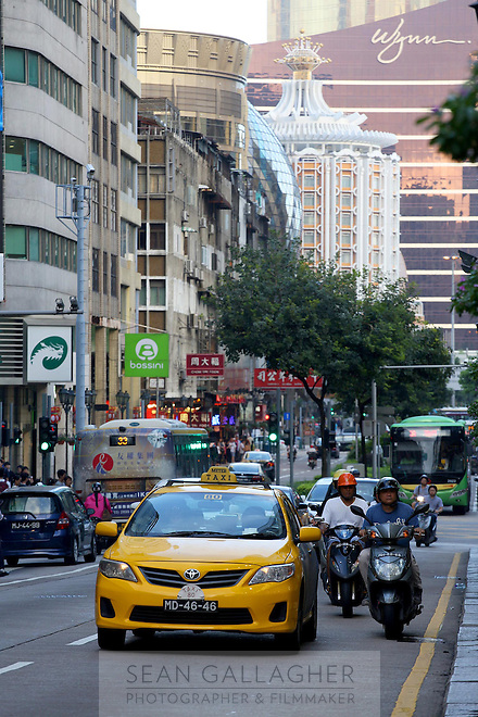 Traffic passes down a busy street in central Macao.<br />