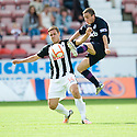 Partick's Paul Lawless goes in high on Dunfermline's Stephen Husband.