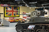 BNPS.co.uk (01202) 558833. <br /> Pic: TankMuseum/BNPS<br /> <br /> Pictured: The falgs on display at the War Storied exhibition at the The Tank Museum, Bovington. <br /> <br /> A Union Jack flag flown in defiance during the Siege of Tobruk is being displayed for the first time alongside a Nazi swastika flag captured during its liberation.<br /> <br /> The Allies held out for eight months in the face of an Afrika Corps onslaught until they were freed by the 8th Army in November 1941.<br /> <br /> The German commander Erwin Rommel was surprised by the aggressive attack, codenamed Operation Crusader, and forced to retreat at a pivotal juncture of the North African campaign.<br /> <br /> In the ensuing chaos, the swastika flag was captured from an 88mm flak gun locker by the advancing 8th Royal Tank Regiment.<br /> <br /> The flags will go on show from next month as part of the new World War Two: War Stories exhibition at the Tank Museum in Bovington, Dorset.