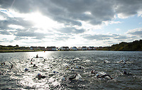 16 AUG 2014 - DARTFORD, GBR - Competitors head for the next buoy as they swim their first lap of the 2014 Midnight Wo/Man triathlon in The Bridge Lakes in Dartford, Great Britain (PHOTO COPYRIGHT © 2014 NIGEL FARROW, ALL RIGHTS RESERVED)