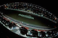 The speedway at night as the car streak by...2002 Rolex 24 at Daytona, Daytona International Speedway, Daytona Beach, Florida USA Feb. 2002.(Sports Car Racing)