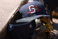 A Gwinnett Braves cap rests on top of a glove on the top step of the visitors dugout at Knights Castle April 9, 2009 in Fort Mill, South Carolina. (Photo by Brian Westerholt / Four Seam Images)