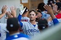 Surprise Saguaros designated hitter Cavan Biggio (26), of the Toronto Blue Jays organization, is congratulated by his teammates in the dugout after hitting a home run during an Arizona Fall League game against the Mesa Solar Sox at Sloan Park on November 1, 2018 in Mesa, Arizona. Surprise defeated Mesa 5-4 . (Zachary Lucy/Four Seam Images)