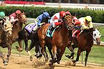 Satisfied Mind with Alex Solis (red cap) wins the 8th race at Churchill Downs. 05.15.2010