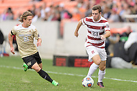 Houston, TX - Friday December 11, 2016: Sam Werner (23) of the Stanford Cardinal brings the ball up the field with Hayden Partain (21) of the Wake Forest Demon Deacons in pursuit at the NCAA Men's Soccer Finals at BBVA Compass Stadium in Houston Texas.