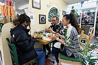 Pictured: Locals enjoy a meal at Iokasti's Greek restaurant in Swansea Indoor Market, Wales, UK. Monday 17 May 2021<br /> Re: Restrictions implemented by the Covid-19 Coronavirus pandemic, have been relaxed with hospitality business being allowed to open their indoors spaces in Wales, UK.