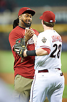 Arizona Diamondbacks guest Darnell Dockett #90 of the Arizona Cardinals after throwing out out a first pitch with Chris Johnson #28 before a National League regular season game against the Colorado Rockies at Chase Field on October 2, 2012 in Phoenix, Arizona. Arizona defeated Colorado 5-3. (Mike Janes/Four Seam Images)