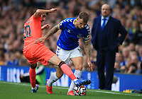 25th September 2021; Goodison Park, Liverpool, England; Premier League football, Everton versus Norwich;     Lucas Digne of Everton is tackled by Pierre Lees-Melou of Norwich City