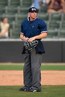 Home plate umpire Chris Graham between innings of a South Atlantic League game between the Lake County Captains and the Kannapolis Intimidators at Fieldcrest Cannon Stadium May 3, 2009 in Kannapolis, North Carolina. (Photo by Brian Westerholt / Four Seam Images)