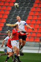 USA forward Abby Wambach stretches high to place a header on goal.  The USA defeated Norway 2-1 at Olhao Stadium on February 26, 2010 at the Algarve Cup.