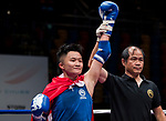The judge rises the arm of Tsang Ching Yee (Blue) of Hong Kong as she wins the gold medal in the female muay 54KG division weight bout during the East Asian Muaythai Championships 2017 at the Queen Elizabeth Stadium on 13 August 2017, in Hong Kong, China. Tsang Ching See won the gold over opponent Purevjav Davaa of Mongolia. Photo by Yu Chun Christopher Wong / Power Sport Images