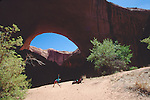 Utah, Coyote Gulch, Jacob Hamblin Arch, Escalante Canyon, Glen Canyon National Recreation Area, Utah, Woman stretching, Maggie Coon, model released,. .