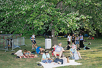 People sit in the shade listening to speakers in the protest area in FDR Park outside of the secure area surrounding the Democratic National Convention at the Wells Fargo Center in Philadelphia, Pennsylvania, on Wed., July 27, 2016.