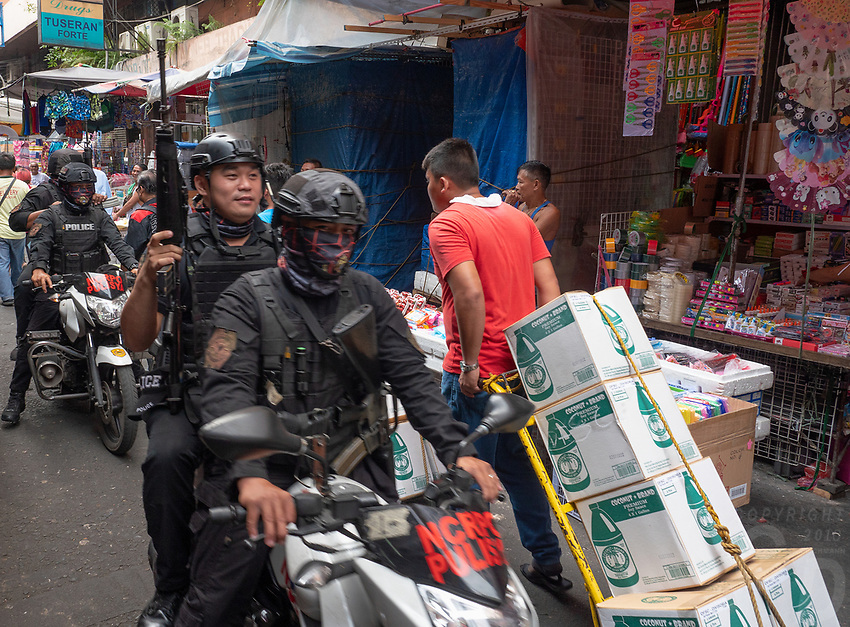 Heavy armed Police on their Bikes in China Town,Street Photography in Manila, Devisoria and China Town, Philippines
