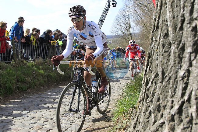 The tail end of the peloton including Gregor Gazvoda (SLO) AG2R La Mondiale climbs Koppenberg during the 96th edition of The Tour of Flanders 2012, running 256.9km from Bruges to Oudenaarde, Belgium. 1st April 2012. <br /> (Photo by Eoin Clarke/NEWSFILE).