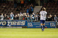 Wycombe Wanderers supporters congratulate the team and Gareth Ainsworth (Manager) of Wycombe Wanderers (right) on their victory during the The Checkatrade Trophy match between Northampton Town and Wycombe Wanderers at Sixfields Stadium, Northampton, England on 30 August 2016. Photo by David Horn / PRiME Media Images.