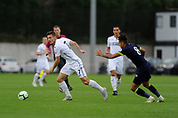 Monday 20th August 2018<br /> Pictured: Swansea City's Adnan Maric vies for possession with Derby County's Kellan Gordon<br /> Re: Swansea City U23 v Derby County U23 Premier League 2 match at the Landore Training facility, Swansea, Wales, UK