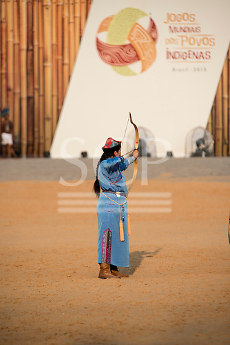 A female Mongol indigenous archer demonstrates her archery technique at the International Indigenous Games, in the city of Palmas, Tocantins State, Brazil. Photo © Sue Cunningham, pictures@scphotographic.com 24th October 2015